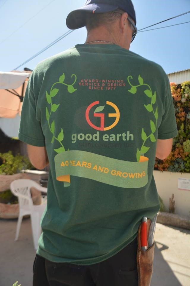 Good Earth employee with 40th anniversary logo on tshirt
